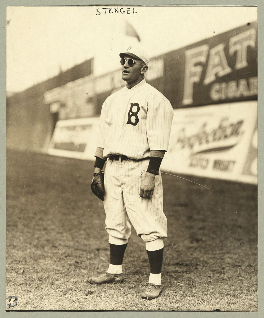 Casey Stengel in Cool Sunglasses, probably Willson, while standing in the outfield at