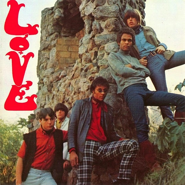 This is the cover of Love's first album.   Note Arthur Lee front and center wearing diamond shaped granny glasses.