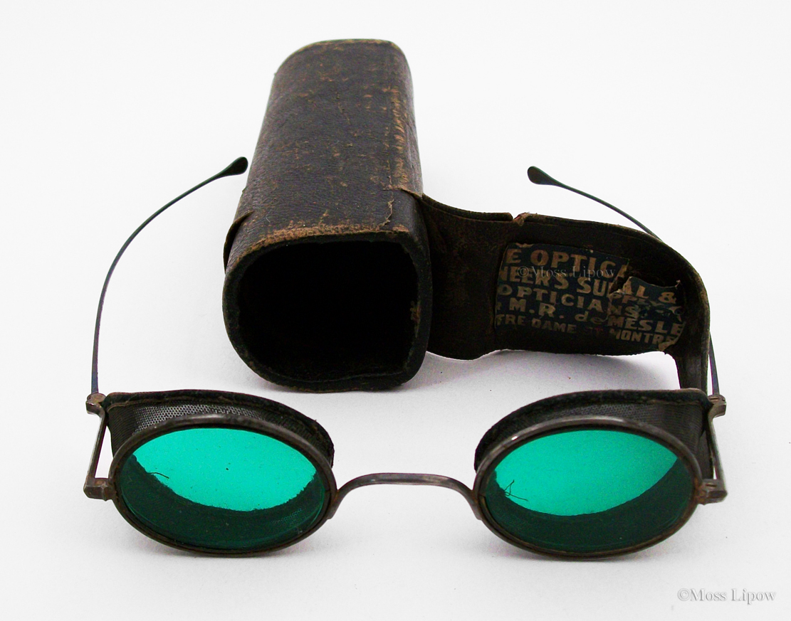 1800s safety glasses, sunglasses really, with fixed mesh side protectors.   Felt is sewn on to the edge of the mesh for the wearer's comfort.
