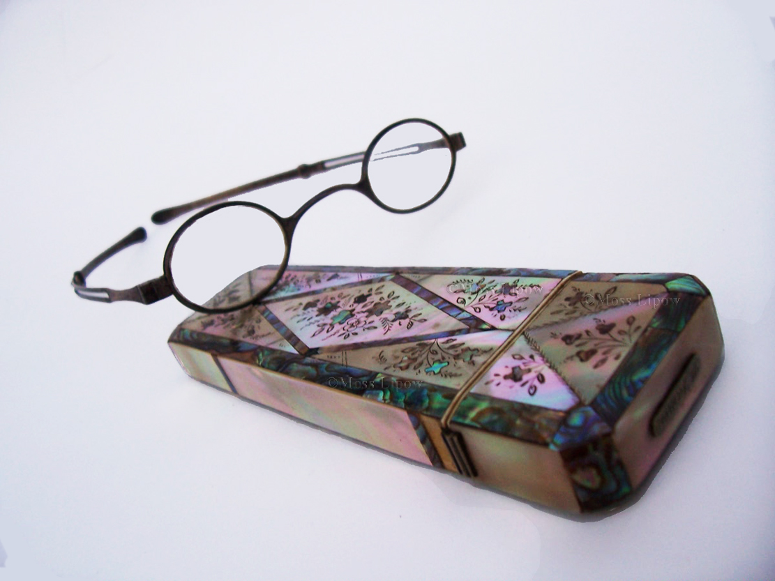 Georgian sterling silver eyeglasses with sliding temples, with mother of pearl and abalone marquettry case.   Circa 1830.