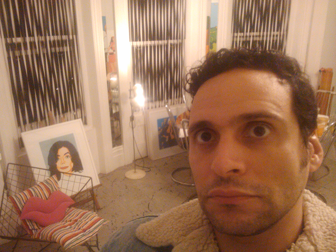 "Syd Barrett's former bedroom is now Duggie Fields' studio.   I took this ""selfie"" exactly where Syd's bed used to be.   Michael Jackson looks on non-plussed."
