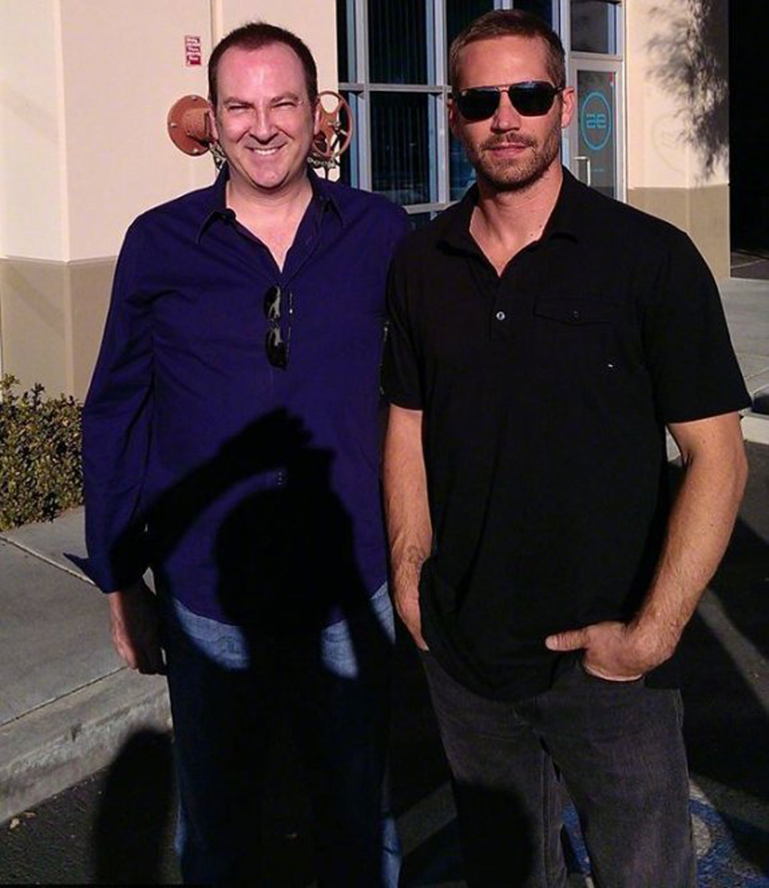 Paul Walker in the death sunglasses with friend Roger Rodas who was also killed.