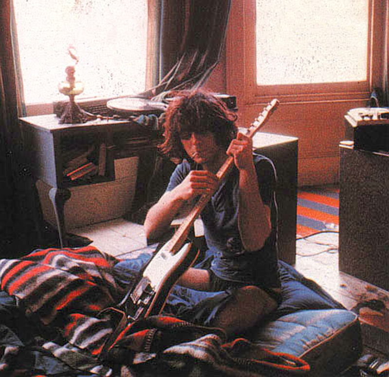 Syd Barrett with guitar from the famous Madcap Laughs photo session shot by Mick Rock.