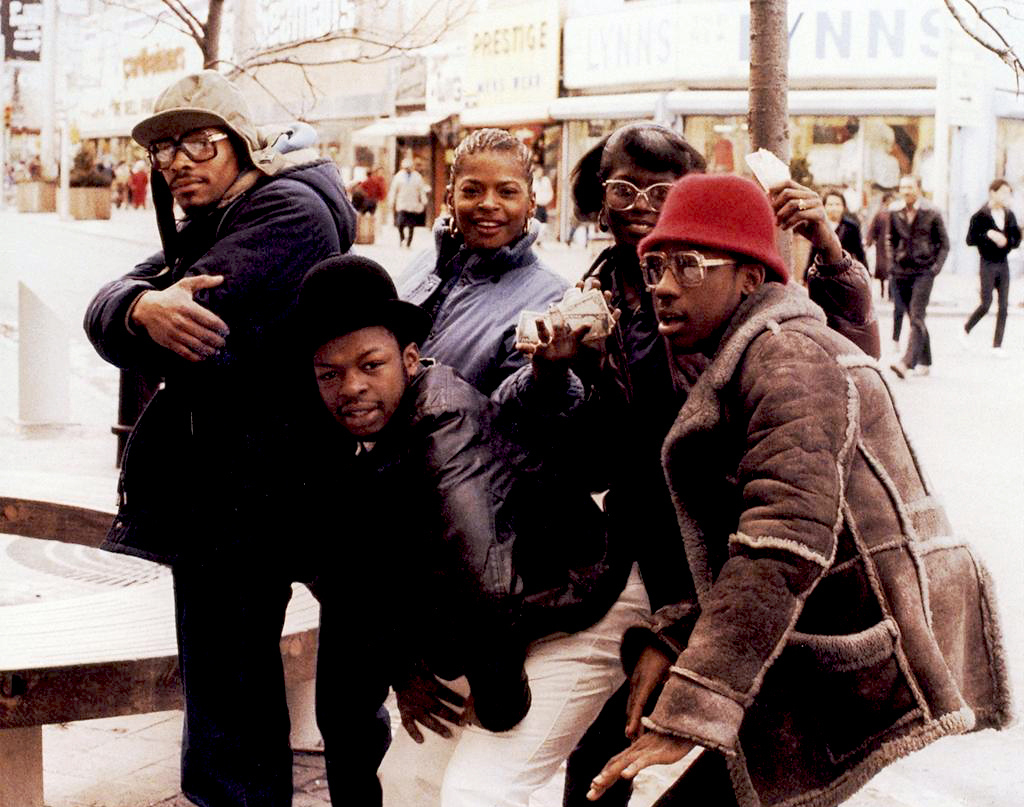 Two guys in Cazal 607s bookend the group. Photo by Jamel Shabazz.