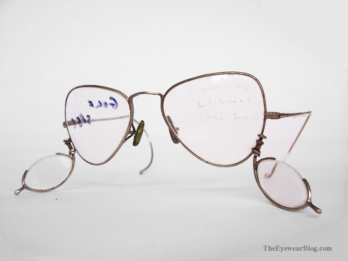 Golfing glasses with adjustable swing-out lenses to help the wearer see the ball better, circa 1940s.