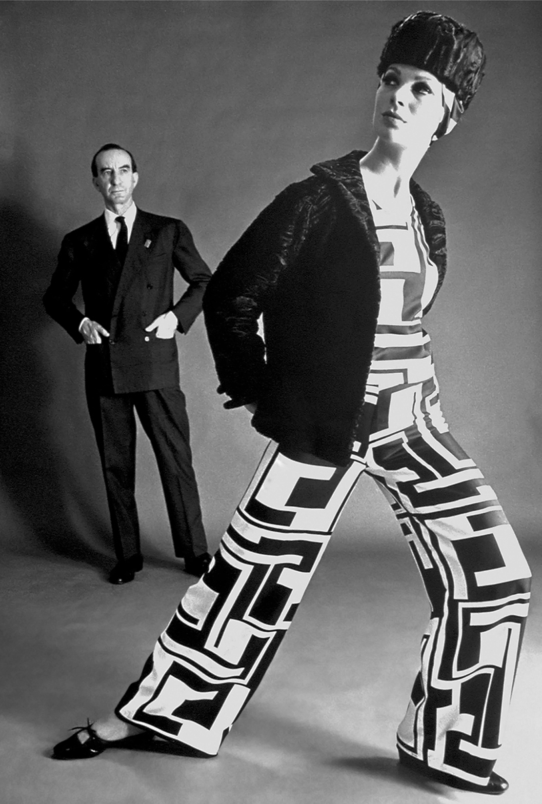 Emilio Pucci and a model wearing his Palazzo Pyjamas from his Fall/Winter 1966 collection.