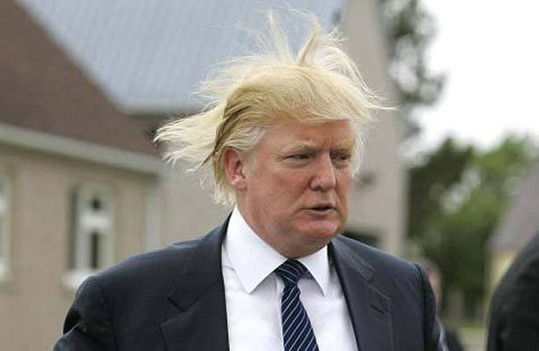 Somewhat gratuitous image of Donald Trump with windblown hair.   If he wasn't famous paparazzi wouldn't be sneaking around taking unflattering pictures of him.